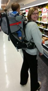 Baby in a backpack carrier - in a supermarket